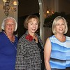 Women's Committee President Lynn Cooper (center) is flanked by Holiday Look In vice chair Marsha Willhite and chair Mona Neter