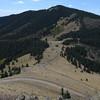Overlook of La Mosca Pass (UNP) taken from La Mosca Peak Lookout Tower looking south towards Mt. Taylor. (October 2009)