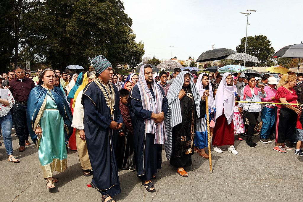 . St. Patrick\'s parishioners portraying the followers of Jesus walk along the Way of the Cross marked out in Ramsay Park. (Dan Coyro -- Santa Cruz Sentinel)