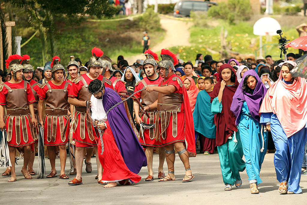 . Watsonville residents in the annual Passion Play portray Roman soldiers beating Jesus and leading him to his crucifiction while his devotees follow, at right. (Dan Coyro -- Santa Cruz Sentinel)