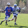 Winnacunnet's #88 James Nash runs the ball up the field with Bobcats #9 Max Stenslie defending during Friday's NHIAA DIV II Boys Lacrosse game between Winnacunnet and Oyster River High School on 4-29-2016 @ Little River Field, Lee, NH.  Matt Parker Photos
