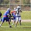 Winnacunnet's #80 Morgan McGirl shoots and scores after penetrating the Bobcat defense with Bobcat Goal Keeper #3 Will Cilia out of position during Friday's NHIAA DIV II Boys Lacrosse game between Winnacunnet and Oyster River High School on 4-29-2016 @ Little River Field, Lee, NH.  Matt Parker Photos