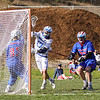 Oyster Rivers #17 Max Litchfield takes a shot on the Winnacunnet net with Goal Keeper #83 Matt Cooney and #77 Mike Lewis defending during Friday's NHIAA DIV II Boys Lacrosse game between Winnacunnet and Oyster River High School on 4-29-2016 @ Little River Field, Lee, NH.  Matt Parker Photos