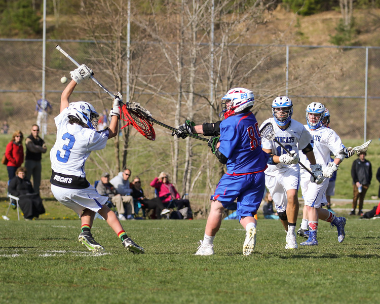Winnacunnet's #89 Lucas Sexton shoots the ball past Bobcat Goal Keeper #3 Will Cilia during Friday's NHIAA DIV II Boys Lacrosse game between Winnacunnet and Oyster River High School on 4-29-2016 @ Little River Field, Lee, NH.  Matt Parker Photos