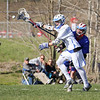 Oyster Rivers #16 Kevin Nichols gets the ball knocked from his net by Winnacunnet's Long Stick Midi #77 Mike Lewis during Friday's NHIAA DIV II Boys Lacrosse game between Winnacunnet and Oyster River High School on 4-29-2016 @ Little River Field, Lee, NH.  Matt Parker Photos