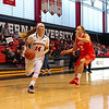 Huskies Freshman #14 Shannon Todd of York Maine drives to the hoop with Terriers #22 Corrine Williams defending during Friday's game Between Northeastern University and Boston University on 11-11-2016 @ NU.  Matt Parker Photos