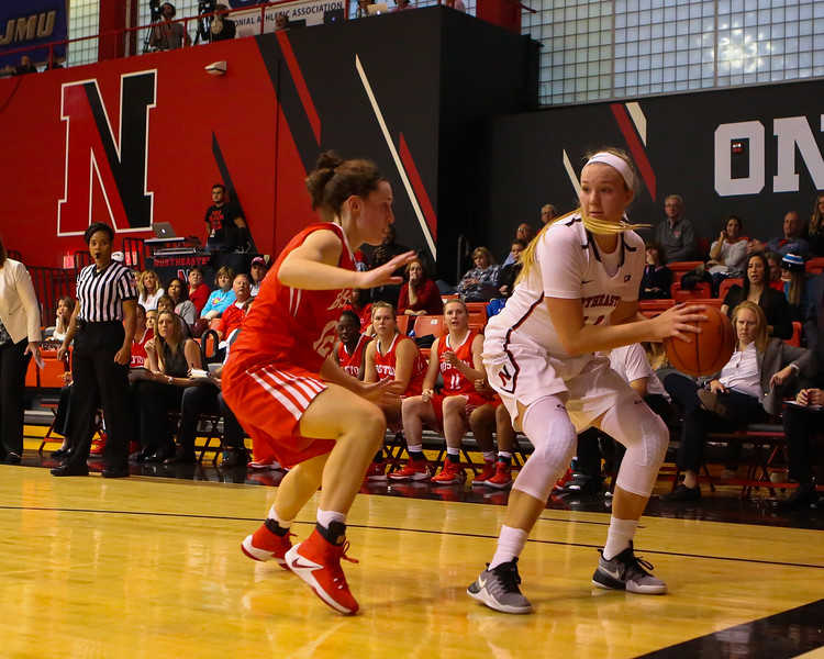 Huskies Freshman #14 Shannon Todd of York Maine looks gets trapped in the corner by Terriers #12 Sarah Hope during Friday's game Between Northeastern University and Boston University on 11-11-2016 @ NU.  Matt Parker Photos
