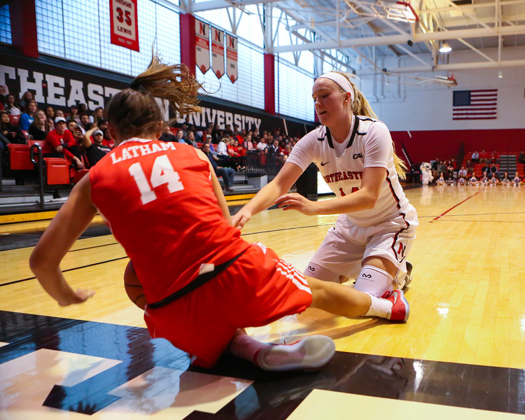 Huskies Freshman #14 Shannon Todd of York Maine jumps on a loose ball with Terriers  #14 Courtney latham getting called for an out of bounds during Friday's Women's DIV I game Between Northeastern University and Boston University on 11-11-2016 @ The Cabot Center, NU.  Matt Parker Photos