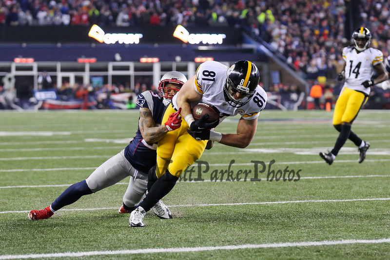 Steelers #81 Jesse James gets 11 yards after catching a pass from QB #7 Ben Roethlisberger before being taken down by Patriots Safety #23 Patrick Chung on the NE 21 at the New England Patriots vs Pittsburgh Steelers  2017 NFL AFC Conference Championships football game on Sunday 1-22-2017 @ Gillette Stadium, Foxboro, MA.  Patriots-36, Steelers-17.  Matt Parker Photos