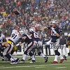 Patriots QB #12 Tom Brady makes a short pass left to WR #15 Chris Hogan for 4 yards to the NE 43 at the New England Patriots vs Pittsburgh Steelers  2017 NFL AFC Conference Championships football game on Sunday 1-22-2017 @ Gillette Stadium, Foxboro, MA.  Patriots-36, Steelers-17.  Matt Parker Photos