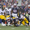 Patriots RB #33 Dion Lewis gets tackled by Steelers #50 Ryan Shazier and #92 James Harrison at the New England Patriots vs Pittsburgh Steelers  2017 NFL AFC Conference Championships football game on Sunday 1-22-2017 @ Gillette Stadium, Foxboro, MA.  Patriots-36, Steelers-17.  Matt Parker Photos