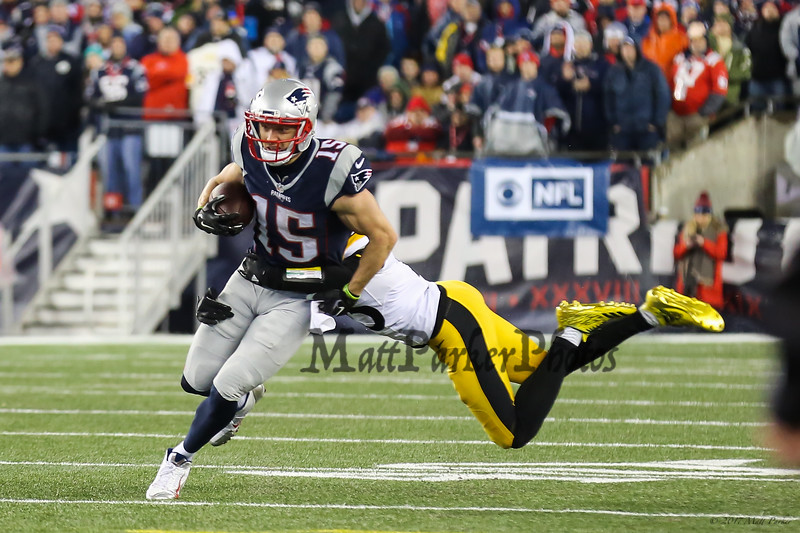 Patriots WR #15 Chris Hogan looking up field with Steelers #25 Artie Burns making a tackle  at the New England Patriots vs Pittsburgh Steelers  2017 NFL AFC Conference Championships football game on Sunday 1-22-2017 @ Gillette Stadium, Foxboro, MA.  Patriots-36, Steelers-17.  Matt Parker Photos