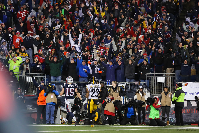 Patriots WR #15 Chris Hogan takes the ball into the endzone for a touchdown with Steelers #23 Mike Mitchell trailing at the New England Patriots vs Pittsburgh Steelers  2017 NFL AFC Conference Championships football game on Sunday 1-22-2017 @ Gillette Stadium, Foxboro, MA.  Patriots-36, Steelers-17.  Matt Parker Photos