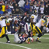 Steelers WR #14 Sammie Coates breaks a tackle by Patriots DB #43 Nate Ebner with #31 Jonathan Jones at the New England Patriots vs Pittsburgh Steelers  2017 NFL AFC Conference Championships football game on Sunday 1-22-2017 @ Gillette Stadium, Foxboro, MA.  Patriots-36, Steelers-17.  Matt Parker Photos