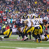 Patriots RB #29 LeGarrette Blount breaks through the Steelers line  for some short yards during the New England Patriots vs Pittsburgh Steelers  2017 NFL AFC Conference Championships game on Sunday 1-22-2017 @ Gillette Stadium, Foxboro, MA.  Patriots-36, Steelers-17.  Matt Parker Photos