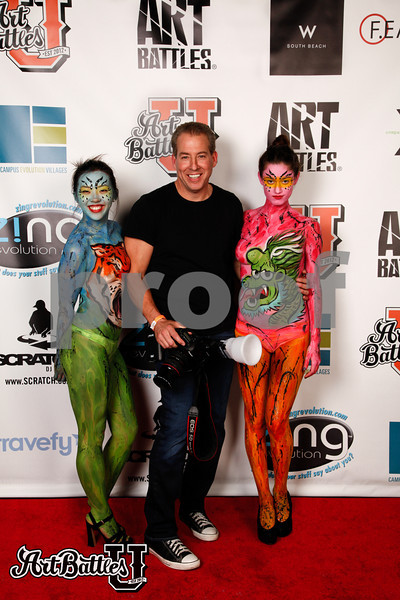 Photographer William Madden posing on the ABU Red Carpet with Bodypaint.Me models.