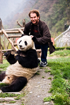 Charlie and a panda at the Wolong Panda Reserve in Chengdu, China