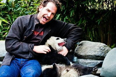 Charlie and a baby panda at the Wolong Panda Reserve in Chengdu, China