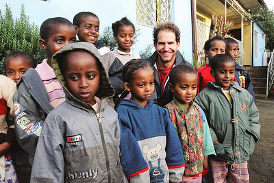 Charlie with children at the Abebech Gobena Orphanage, Addis Ababa, Ethiopia