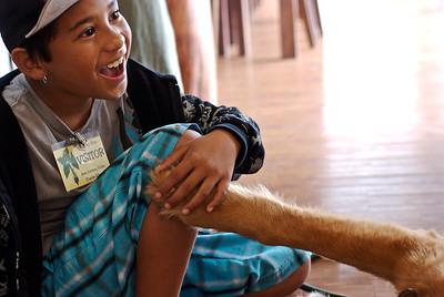 A student at the Kanu O Ka Aina Charter school petting Lucky