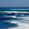 Surfers off the coast of Oahu, Hawaii