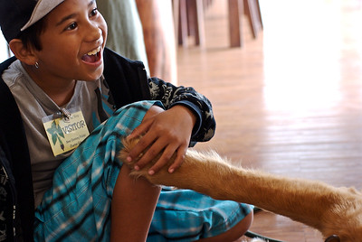A student at the Kanu O Ka Aina Charter school petting Lucky