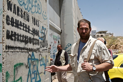 Charlie at the Israeli West Bank barrier in Bethlehem, Israel