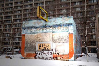 Historic Whites Records. A city still run down, covered by fields and abstract pastels of weathered paint, Detroit.