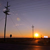 Crossing telephone lines stretch out over the sunset on WHY 61 near Rolling Fork MS