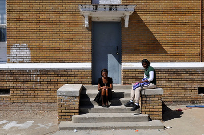 Students sit outside of class at Shaw High School