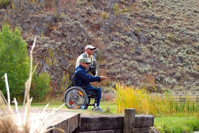 Sun Valley. Wounded Soldiers with PTSD Fly Fishing in Eedaho Pond
