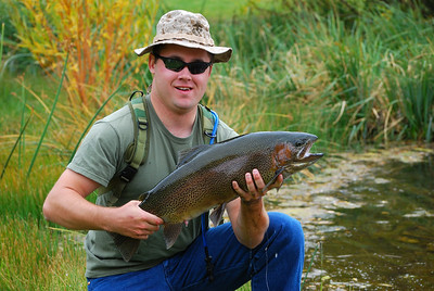 Soldiers with PTSD fly fishing with staff instuctors at Eedaho Pond, Sun Valley