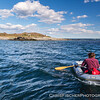 Stratton Island Supervisor John Gorey rows supplies ashore in a rubber dinghy.