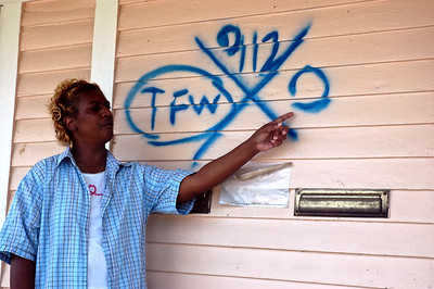 New Orleans resident, Annette, pointing to the markings left on her home by a search and rescue team
