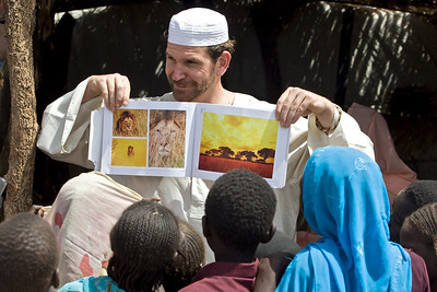 Charlie and a group of local children in Gereida, South Darfur, Sudan