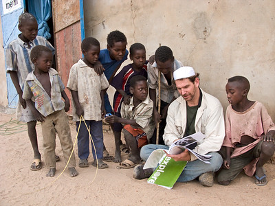 Charlie talking with local children at the Merlin medical center in Gereida, Sudan