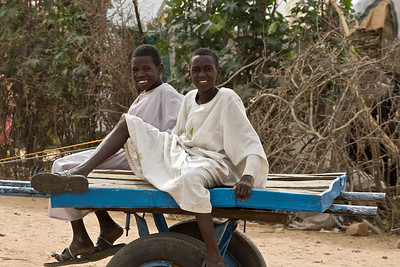 Boys on a donkey cart in Gereida, Sudan