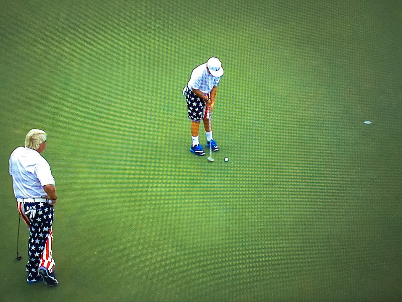 """2016-12-10 – I saw John Daly win at Riverside to qualify for the PGA tour many years ago. Today I turned on the TV and they were playing the PNC Father/Son Challenge. John Daly was playing with his son """"Little John"""" or John Daly Jr. He is only 13 but was so good and comfortable under the pressure. I was really impressed. I took this photo on my TV to remember the day I first saw him play. He will likely do better than his dad on the tour when he is old enough. He was really fun to watch and grabbed the attention of all the event coverage people."""