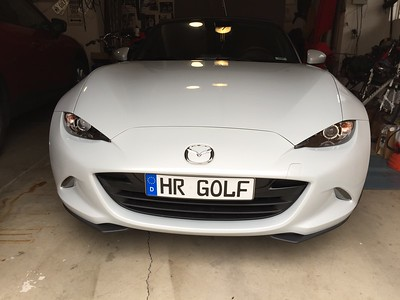2016-12-27 – I purchased this plate in Germany a few years ago and had planned to put it on my BMW, but I never moved my MR.GOLF plate from the truck to the Z3. When I got my new Mazda MX-5 Roadster I immediately transferred the plates, so it made sense to finally put the European/German plate on the front. I love the look. It's just held on with heavy duty velcro so I hope the heat of summer doesn't cause the tape stickum to lose its grip.