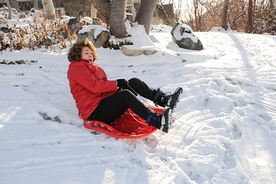 2016-12-28 – We were babbysitting  Aili and Estee and took them outside to sled on the front yard. Grandma Lisa was showing them how to do it. If you ask me, she is having too  much fun.