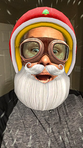 2016-12-22 – I did an update to my iPhone and discovered a new text feature that does like Snapchat. You pick the mask and it matches it to your face. As you move it moves with you. On this one, when I would open my mouth snow flakes would fly by like I was skiing downhill. I thought it was so funny so of course I took a photo. A Santa Selfie.