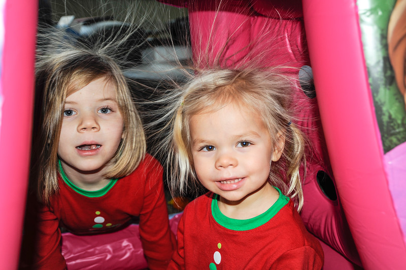 2016-12-26 – We went over to see the gifts Santa  left Aili and Estee, and we set up the tiny bounce house we gave Estee. When they crawled in the static hit their hair and made it stand on end. They had no idea when I was taking the picture.