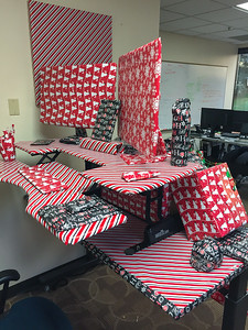 2016-12-20 – Tim's wife came down sick so he took the day off to help take care of their baby and her. Since he was out we decided to bring him a little Christmas spirit by wrapping everything in his office. This might be more gifts than he has ever received.