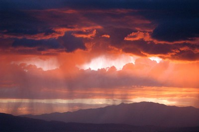 Sunset and summer rain over Lake Mountain in Utah County shot from very near my home.