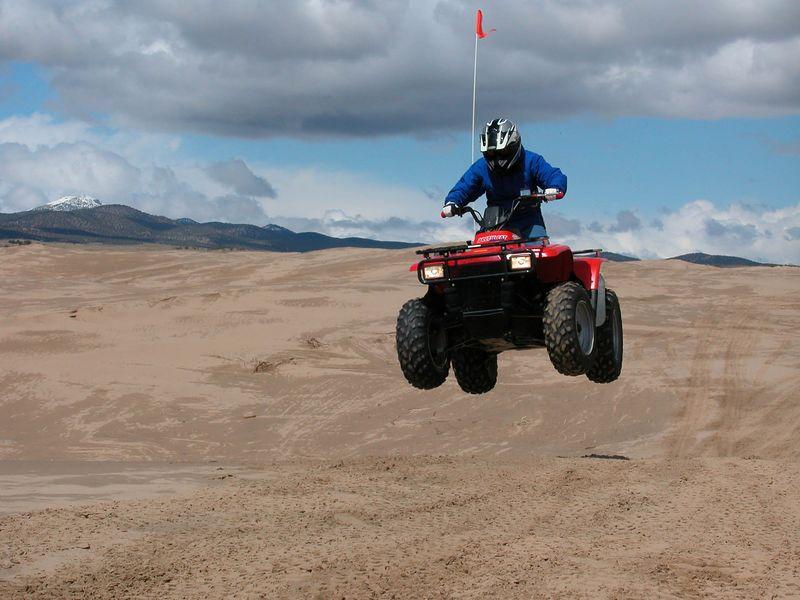 This is my youngest, Sean. He was 11 years old when I took him to the dunes for the first time. For an 11 year old he was really aggressive and had no problem handling the 500 pound machine.