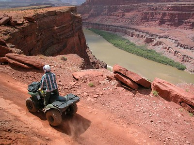 Chicken Corner near Dead Horse Point, Utah.  I generally prefer to shoot landscape without people in them, but the ATV rider anchored the image, created perspective and added to the story that the image had to share.