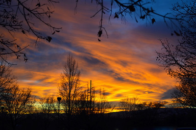 2011/12/28 – This evening I was at work and looked out the window in my office and saw this wonderful sunset. I grabbed the camera and ran downstairs and out into the parking lot to get this image. It was one of the best sunsets of the year.