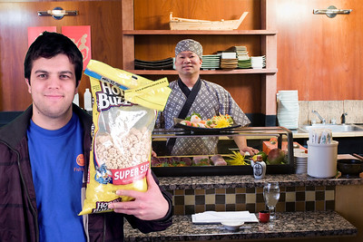 2011/12/6 – This was my first test shot in the new studio. Andrew was leaving for the day with his big bag of cereal. I had him come into the studio were I shot him against the green screen. Once I had the shot I looked for something fun put in the background. I like the irony of Andrew holding a big bag of Honey Buzzards cereal while standing in a very fancy sushi restaurant. Looks like he is really there.