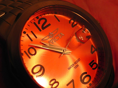 2011/12/18 - I was playing with the macro feature on one of my cameras and decided to try it out on the watch I was wearing that evening. The face is a bright orange so I was trying to capture the richness of the color, as well as get a sharp Invicta logo. This was the best of the images.