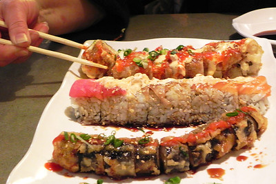 2011/12/31 – Well, this is the last image of 2011 for my project 365. For New Years  Eve, Lisa and I went out for Sushi. We had just had sushi for our anniversary back on the 20th, but it was so good we went again tonight. It was fantastic, but I ate way too much. This was just 3 of the 11 rolls Lisa and shared.  Check out my Project 366 2012 starting tomorrow. Yes, I said 366. 2012 is a leap year so we get one extra day. I've never done a Project 366 and since you only get the chance every four years, I'm going to take it on.
